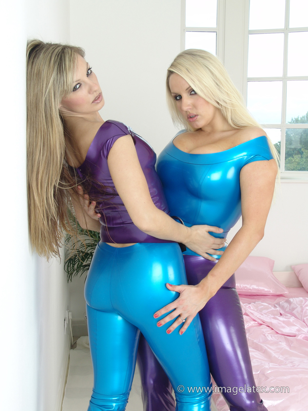 Two blonde latex lesbians playing